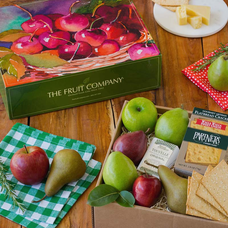 """They say """"two's company, three's a crowd"""", but that old saying doesn't hold true any more! Experience this natural troika - two flavors of hand-milled creamy cheese from Oregon, juicy and out-of-this-world apples, and the smooth sweetest of seasonal handpicked pears. The only question that remains is who will be the recipient - your best friends, your anniversary-celebrating parents or maybe yourself?"""