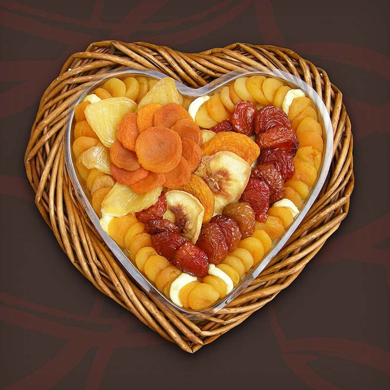 Love Preserved is a custom heart-shaped basket filled with assorted dried fruit delicacies - luscious California yellow and white peaches, tangy Angelino plums, sweet pears, and delicious Mediterranean apricots.