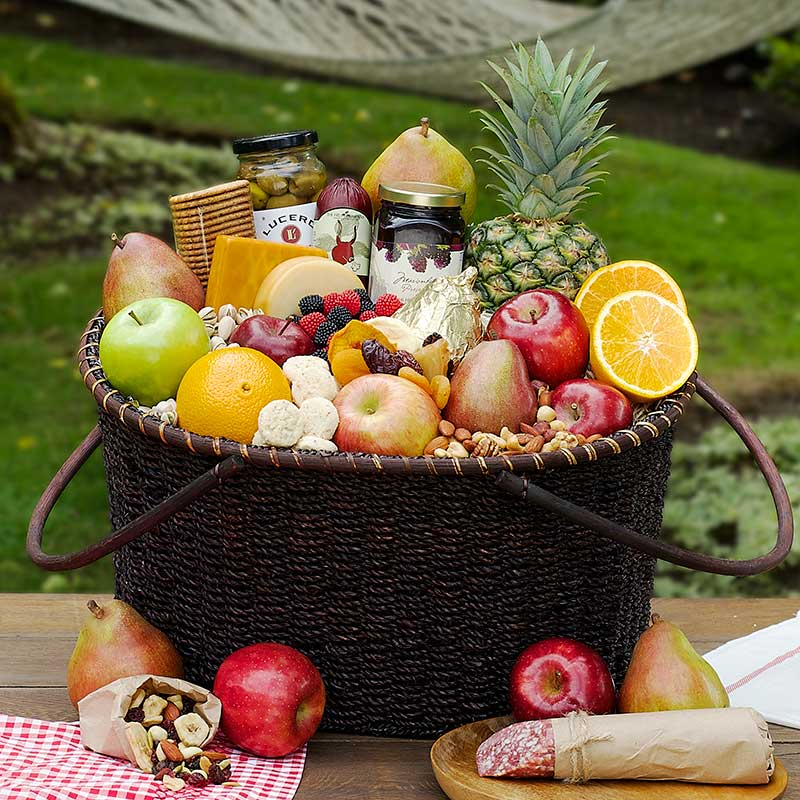 Our gorgeous handcrafted basket is filled from top to bottom with fresh fabulous fruit and gourmet delicacies such as smoked sockeye salmon, colossal pistachios and creamy cheeses perfect for a family gathering or a group gift.