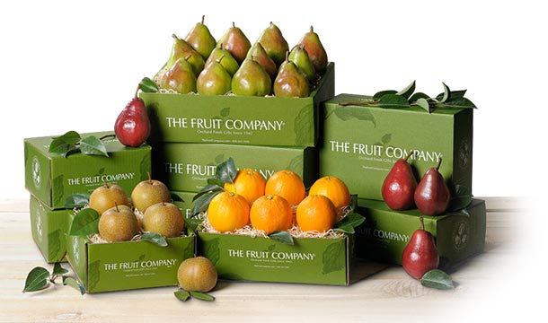 Boxes of outstanding fruit containing pears, oranges, and apples